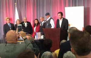 TRC Commissioners stand with representatives of Residential School Survivors at the delivery of the final report