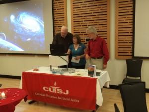 Jim Sannes, Leslie Kemp, & keynote speaker Guy Dauncey try to fix the video. AGM 2016